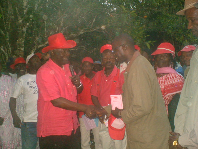 ALFRED_ISHMAIL_SESAY__MARSHAL__RECEIVES_HIS_MEMBERSHIP_CARD_FROM_THE_LEADER