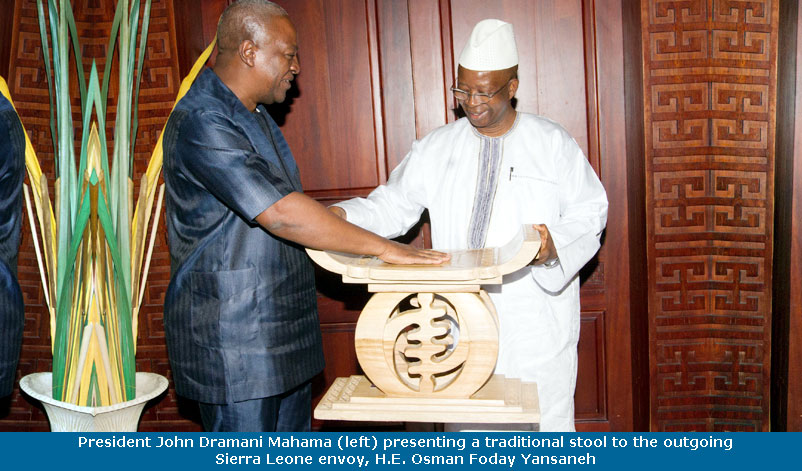 mahama_presenting_stool_to_osman_foday