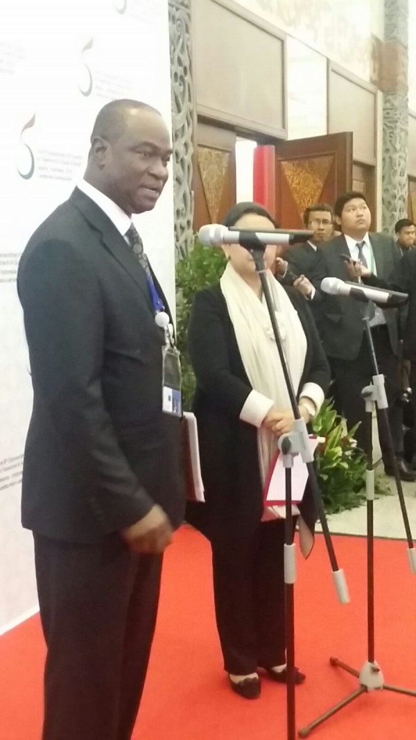 Dr. Samura addressing a news conference in Jakarta