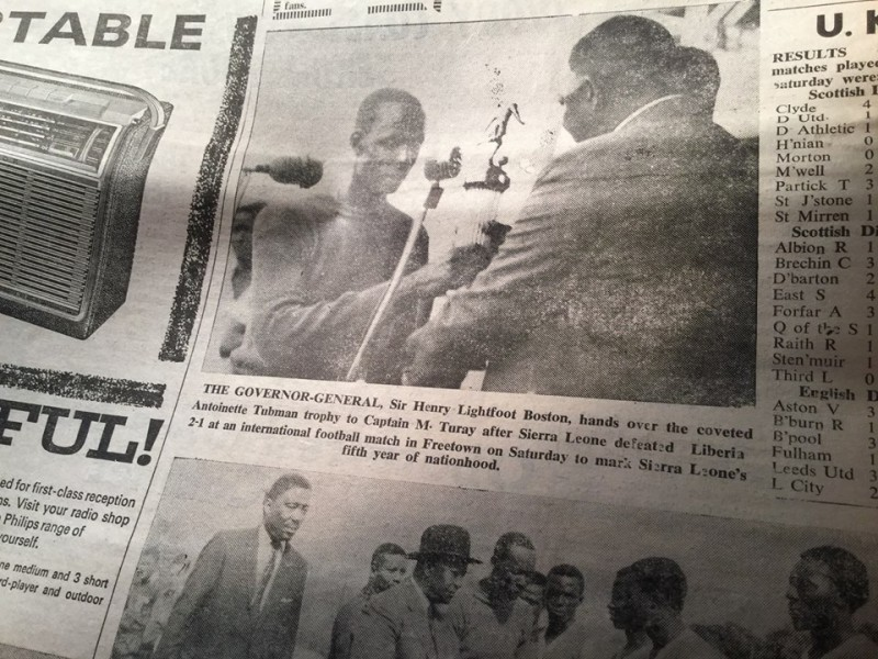 MAHMOUD TURAY, THE CAPTAIN OF THE SIERRA LEONE NATIONAL TEAM, RECEIVING THE TROPHY FROM THE GOVERNOR GENERAL, AFTER SIERRA LEONE DEFEATED LIBERIA.  CREDIT : KABS KANU OF COCORIOKO ( THROUGH THE SIERRA LEONE DAILY MAIL, MONDAY MAY 2, 1966).