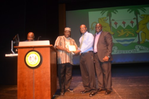 Dr. Brima Diallo receiving his prestigious Award