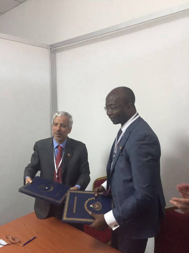 Dr. Patrick Saidu Conteh, (right) Minister of State after the signing agreement