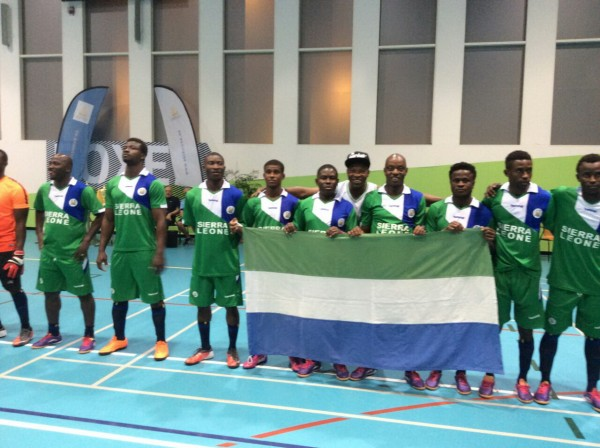 The winning team display Salone flag