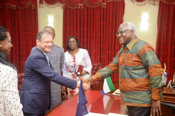 president koroma in warm handshake with outgone french  ambassador